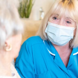A carer wearing face mask at one of our care homes