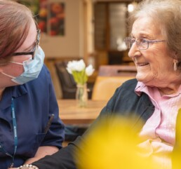 Resident at Walton Manor Care Home in Wakefield chatting with a carer