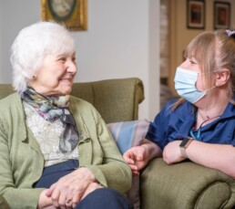 Joan spends some time chatting with her carer at Monson Care Home in Lincoln